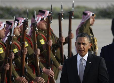 U.S. President Barack Obama is greeted by Bedouin Jordanian honour guards upon his arrival at Amman airport